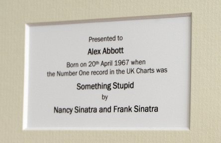 Framed vinyl records including Number One songs from the UK