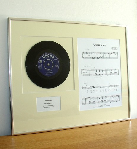 Framed vinyl record and sheet music. A perfect gift for music lovers.